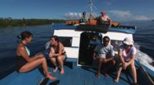 Scuba Divers Travel To Dive Site On Diving Boat At Bunaken Island