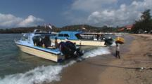 Crew Carrying Equipment To Diving Boats At Padangbai, Bali