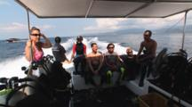 Scuba Divers Travel To Dive Site In Speedboat