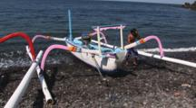Indonesian Man With Small Prahu Boat At Tulamben, Bali