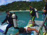 Scuba Divers Jump Into The Water From A Scuba Diving Boat