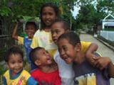 Cute Indonesian Children Smiling At Bunaken Village