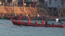 Buddhist Monks Travel In Longtail Boat At Kaw Thaung In Myanmar