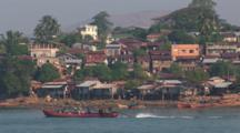Burmese Town, Kaw Thaung, Myanmar With Longtail Boat