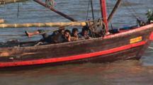 Burmese Boys On Squid Fishing Boat At Kaw Thaung In Myanmar