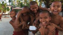 Young Burmese Buddhist Monks Play And Laugh At The Camera