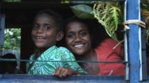 Fijian Girls Look Through Window At Navatu Village