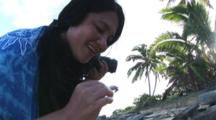 Woman Holds Juvenile Ruggie Hermit Crab, Coenobita Rugosus, On Tropical Beach
