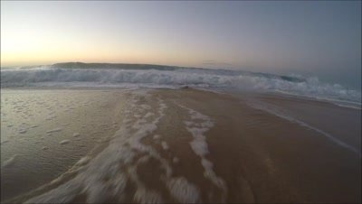 Sunset winter surf slow motion foamy North Shore Oahu,Hawaii