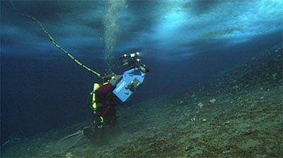 Diver Tethered To Surface Photographs Under Ice