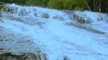 Water Flowing Over Sloping Rock Face