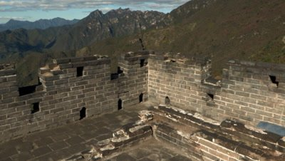 View of the mountains surrounding the Great Wall of China from atop one of it's towers