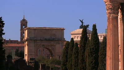 Scenic view of the Arch of Titus, with the National Monument to Victor Emmanuel II in the background