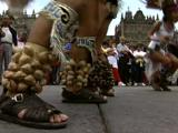 Native South American Indian Dance In City Square. Elaborate Headdress, Bells On Ankles, Large Crowd In B/G