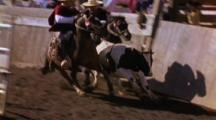 Man Opens Gate As Bull And Two Horsemen Enter Gaucho Rodeo