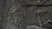 Dolly Glide Shot Along Detailed Carving At Angkor Ruins At Dawn