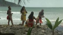 Historical Reenactment Of Kalinago People Arriving On Beach In The Caribbean, start fire
