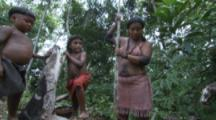 Indigenous People In Amazon Forest,Woman Digs With Pole,Possibly To Find Ants,children watch