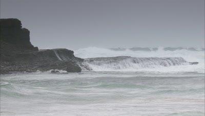 Waves Wash Onto Rugged, Rocky Coast