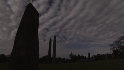 Time Lapse, clouds above silhouetted Ancient Carved Stone Stele In Axum, Ethiopia