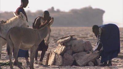 Masaai People Arranging Soda Slabs