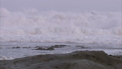 Slow Motion, Frothy Waves on rugged Coast