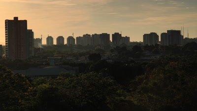 Time Lapse, sunrise Behind City Skyline