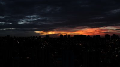 Time Lapse, sunrise Behind City Skyline