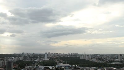 Time Lapse, Clouds Move Above City of Manaus at Sunset