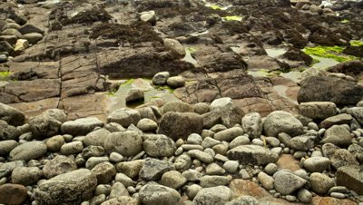 Time Lapse, Close Up Tide rising over Rocky Shore