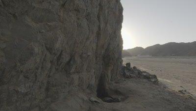 Tilt Down Cliff to View of Desert Valley