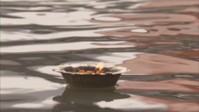 Oil Lamp Floating In Ganges River
