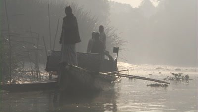 Traditional Fishermen In Boat on Misty River