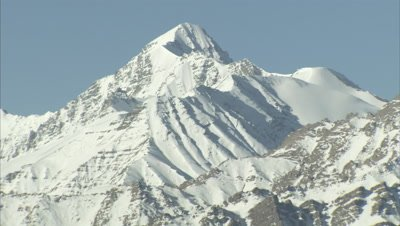 Close up panorama of rugged,snow-capped mountain range