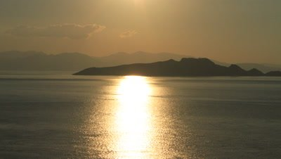 Time lapse of sunset over mountains and ocean at Komodo National Park