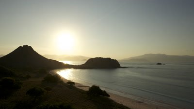 Aerial Time lapse of sunrise over mountains and coastline at Komodo National Park