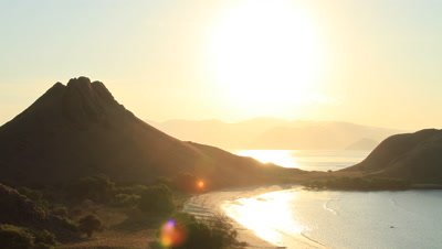 Aerial time lapse of sunset over mountains and coastline at Komodo National Park