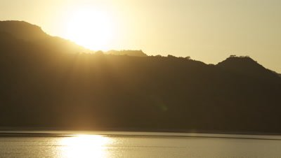 Time lapse of sunrise over mountains and ocean at Komodo National Park