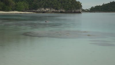 Time lapse of tidal waters move in the sheltered bay of Wayag