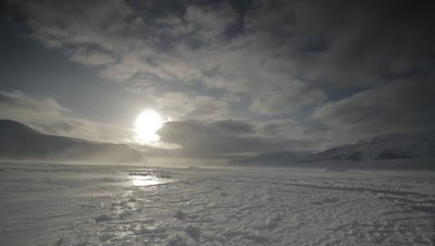 Timelapse clouds/sun moving over the tundra