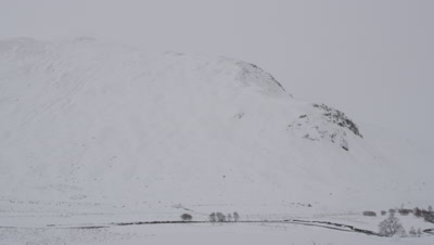 General view of snow covered mountains and cloudy skies
