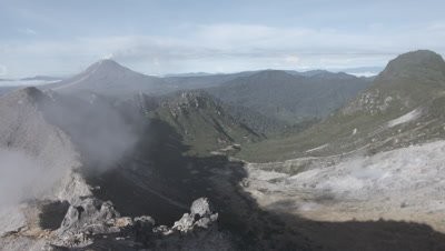 Scenic view of the Sinabung volcano and surrounding mountains from the peak of the Sibayak volcano