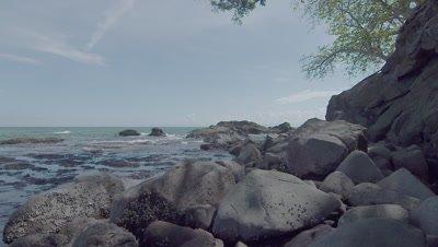 Scenic view of the rocky ocean shoreline on Snake Island, Borneo