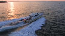 Aerial Powerboat At Sunset