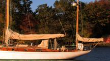 Sailboat Yawl On Mooring With Barn In Background.