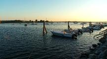 Boats On Skiff Lines At Sunset