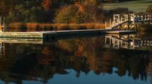 Fall Colors And Reflection On River With Dock