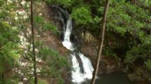Waterfall In Australian Rainforest Empties Into Pool