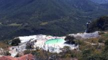 People Swim In Artificial Pool Of Hierve El Agua, Spring-Fed Rock Formation