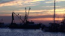 Scenic--Fishing Boat Leaves Harbor At Dawn, Pelicans Flying